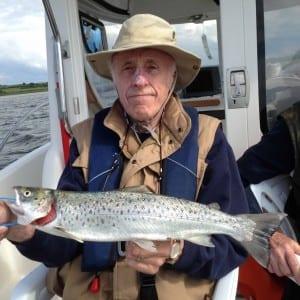 Dr.-Danny-Delargy-shows-a-fine-sea-trout-on Pegasus