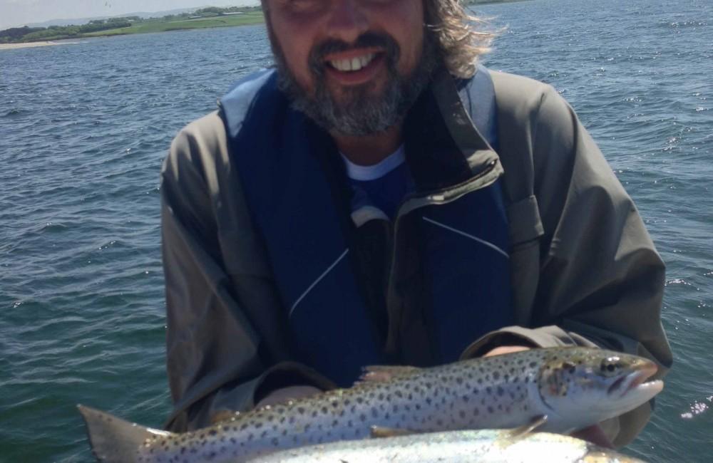 Martin van Seemus shows two fresh run Moy Estuary sea trout on Pegasus